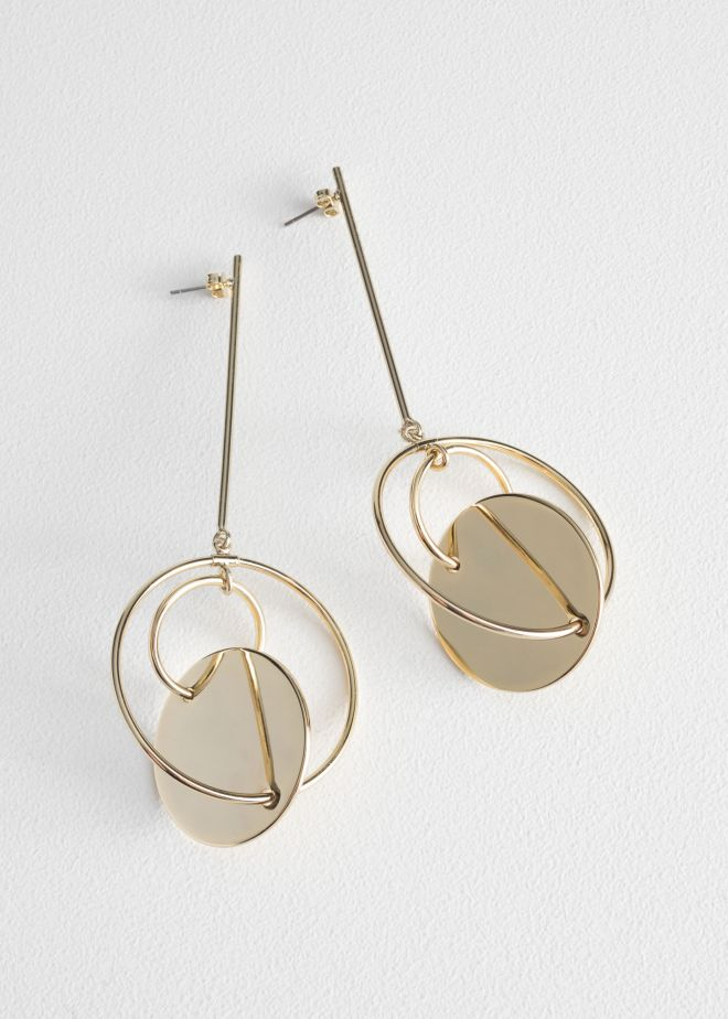 & Other Stories Asymmetric earrings £23